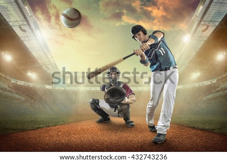 Baseball players in action on the stadium. #432743236