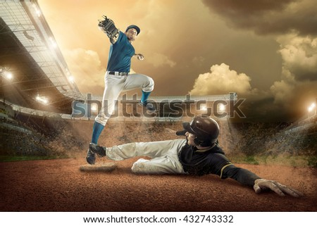 Baseball players in action on the stadium. #432743332