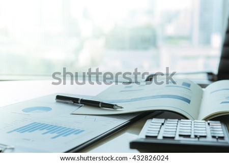 The report summarizes the results of business operations, pen, calculator on desk of investor.  #432826024
