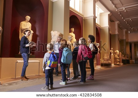 Pupils And Teacher On School Field Trip To Museum With Guide Royalty-Free Stock Photo #432834508