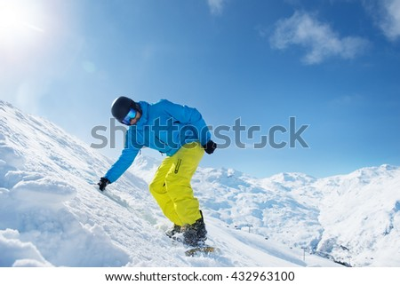 Active man in snowboard outfit in the snowy mountains #432963100