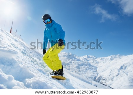 Recreation vacation at a ski resort - snowboarder enjoying snow in the mountains #432963877