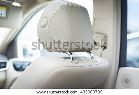 Car passenger leather seat. Interior detail. View from behind Royalty-Free Stock Photo #433000705
