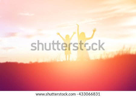 Mother encouraged her son outdoors at sunset, silhouette concept #433066831
