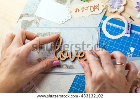scrapbook background. Hands, Card and tools with decoration. Love #433132102