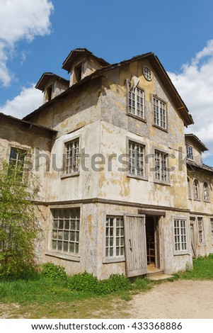 A fragment of an old wooden house. Texture, background, decoration #433368886