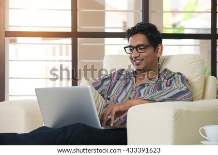 indian male using laptop #433391623