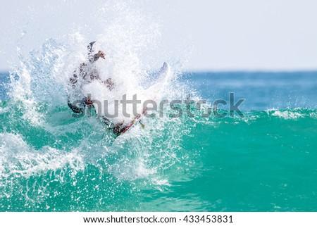Big waves crashing against surfer #433453831