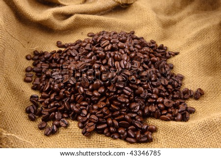 Coffee beans on top of a canvas bag #43346785