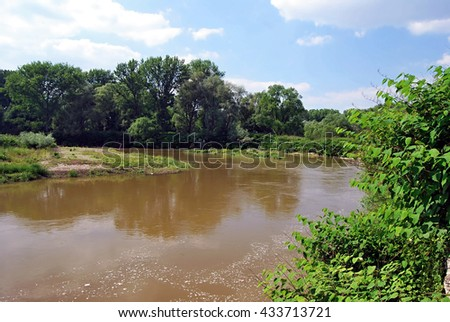 Meander of Odra river on polish-czech boundaries near Chalupki and Bohumin cities during spring afternoon with blue sky and few clouds Royalty-Free Stock Photo #433713721