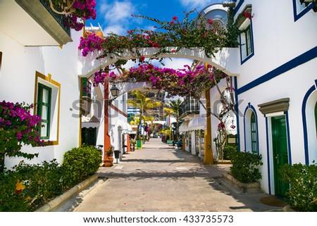 Architecture of Puerto de Mogan, a small fishing port on island Gran Canaria, Spain. Puerto de Mogan is called Little Venice of the canaries. #433735573