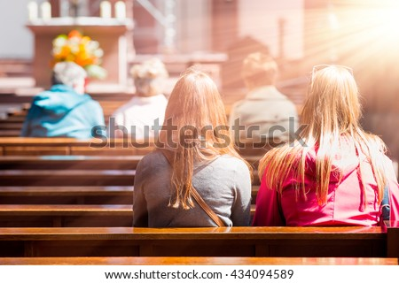 People praying in a church Royalty-Free Stock Photo #434094589