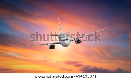 Airplane in the sky at sunrise #434133871