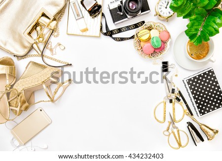 Fashion flat lay for bloggers social media. Feminine accessories, bag, shoes, office supplies, vintage no name photo camera and green plant on white background