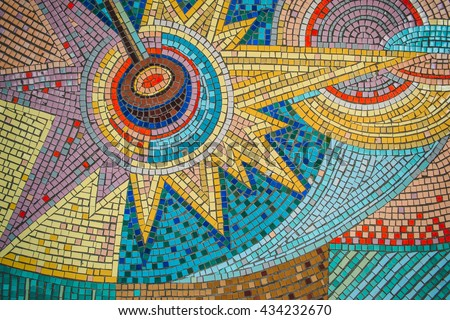 Detail of a beautiful old crumbling abstract ceramic mosaic decoration was destroyed building. Venetian mosaic as a decorative background. Selective focus. Abstract pattern of mosaic.