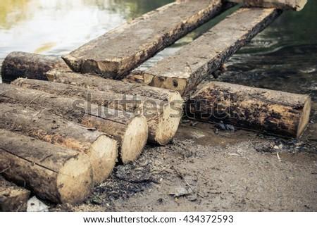 Handmade bridge across a river #434372593