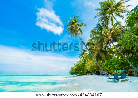 Beautiful tropical beach and sea with coconut palm tree on blue sky in Maldives island - Boost up color Processing #434684107