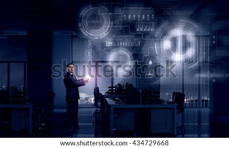 Businessman with tablet device in hands #434729668