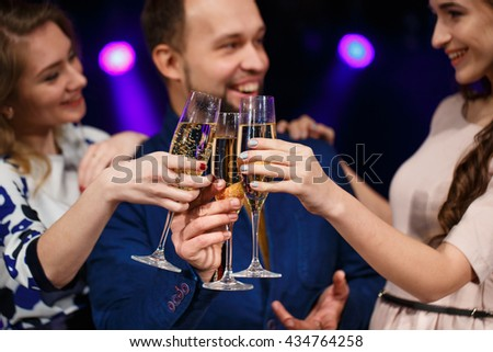 Party, holidays, celebration, nightlife and people concept - smiling friends with glasses of champagne in club #434764258