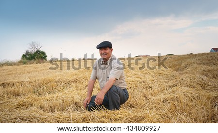 Farmer sitting in the field, waiting for his crop #434809927
