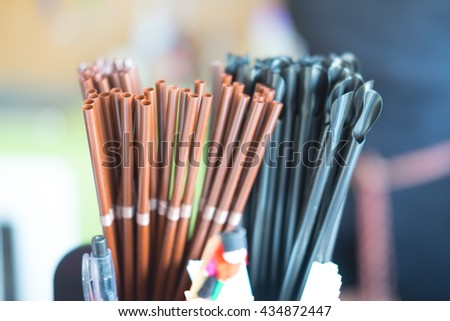 black and brown coffee straws close-up #434872447