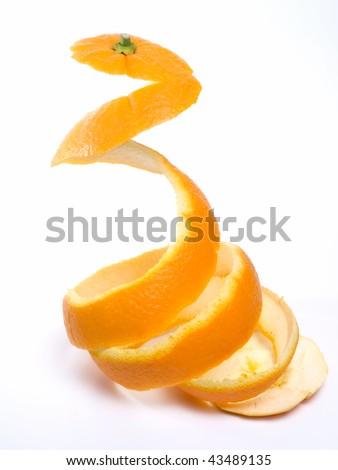 Spiral peeled bark of a ripe orange isolated on white background. #43489135