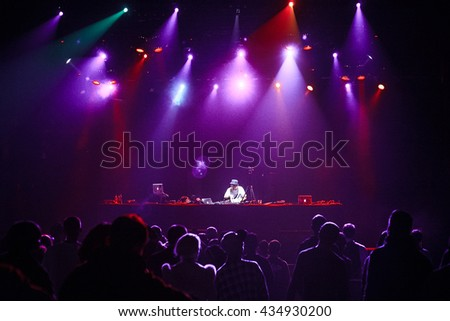 MOSCOW-21 MAY,2016:Famous club dj play live set on stage in the club.Hip hop dj Kentaro scratching vinyl records with music on stage.Music hall event in night club.Bright stage lighting background #434930200