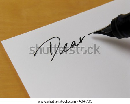 Close-up of pen writing on white paper #434933