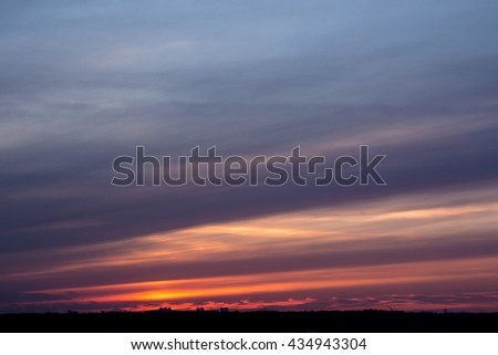 Colorful sunset with clouds in the evening #434943304