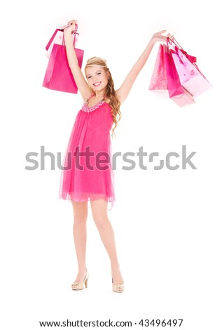 happy woman with shopping bags over white #43496497