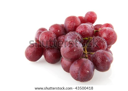 Fresh red grapes with water drops isolated over white #43500418