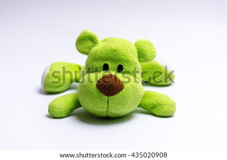 green dog bear stuffed doll on white background