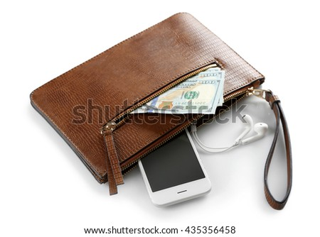 Leather purse with mobile phone and dollar banknotes, isolated on white #435356458