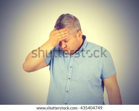 Businessman desperate, depressed, headache. Isolated on background.  #435404749
