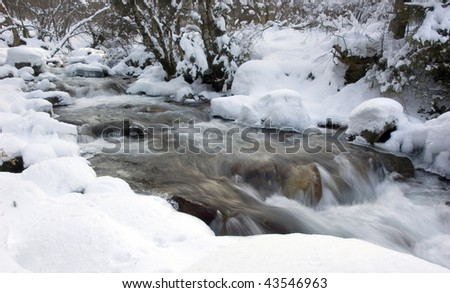 mountain river in winter #43546963