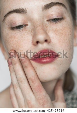 cute face of a beautiful girl with freckles Royalty-Free Stock Photo #435498919