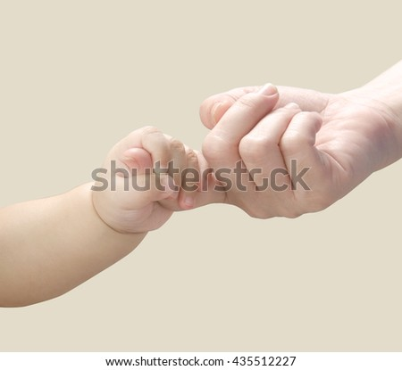 Baby hand holding mother finger. #435512227