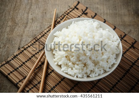Jasmine rice with chopsticks on a bamboo placemat #435561211