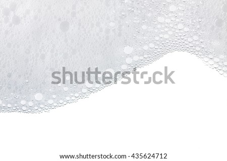 Foam bubbles abstract white background. Detergent Royalty-Free Stock Photo #435624712