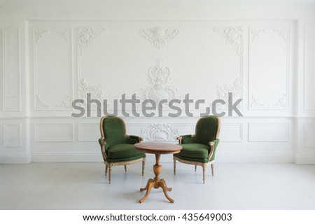portrait of vintage vanity table set with stool over wall design bas-relief stucco mouldings roccoco elements