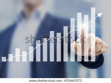Business success with growing, rising charts and businessman in background #435663373
