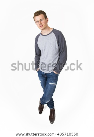 cool boy with cool facial expression  poses in studio isolated on white #435710350