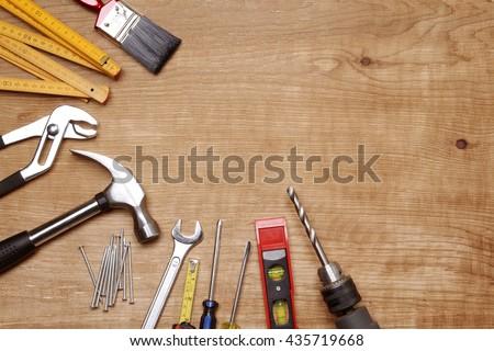 Assorted work tools on wood #435719668