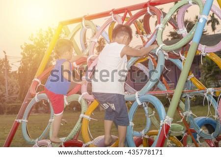 Image of joyful having fun on playground kids outdoors with sunrist #435778171