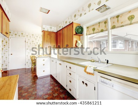 White and brown kitchen interior with tile and floral patterned wall paper #435861211