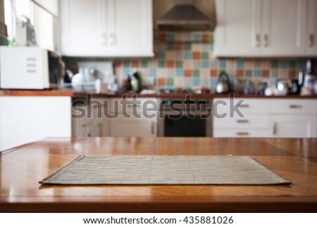 Blurred kitchen interior and napkin and desk space #435881026