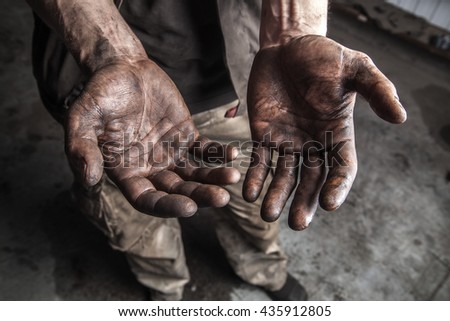 Dirty hands of mechanic at car station #435912805