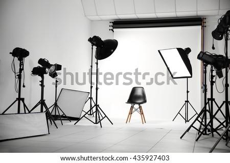 Empty photo studio with lighting equipment #435927403
