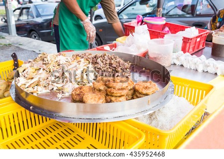Vendor selling cuisine at street bazaar in Malaysia catered for iftar during Muslim fasting month of Ramadan #435952468