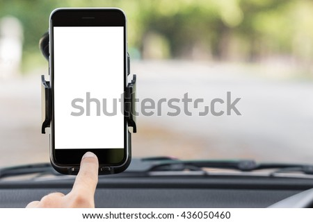 close up hand use phone on mount in car #436050460